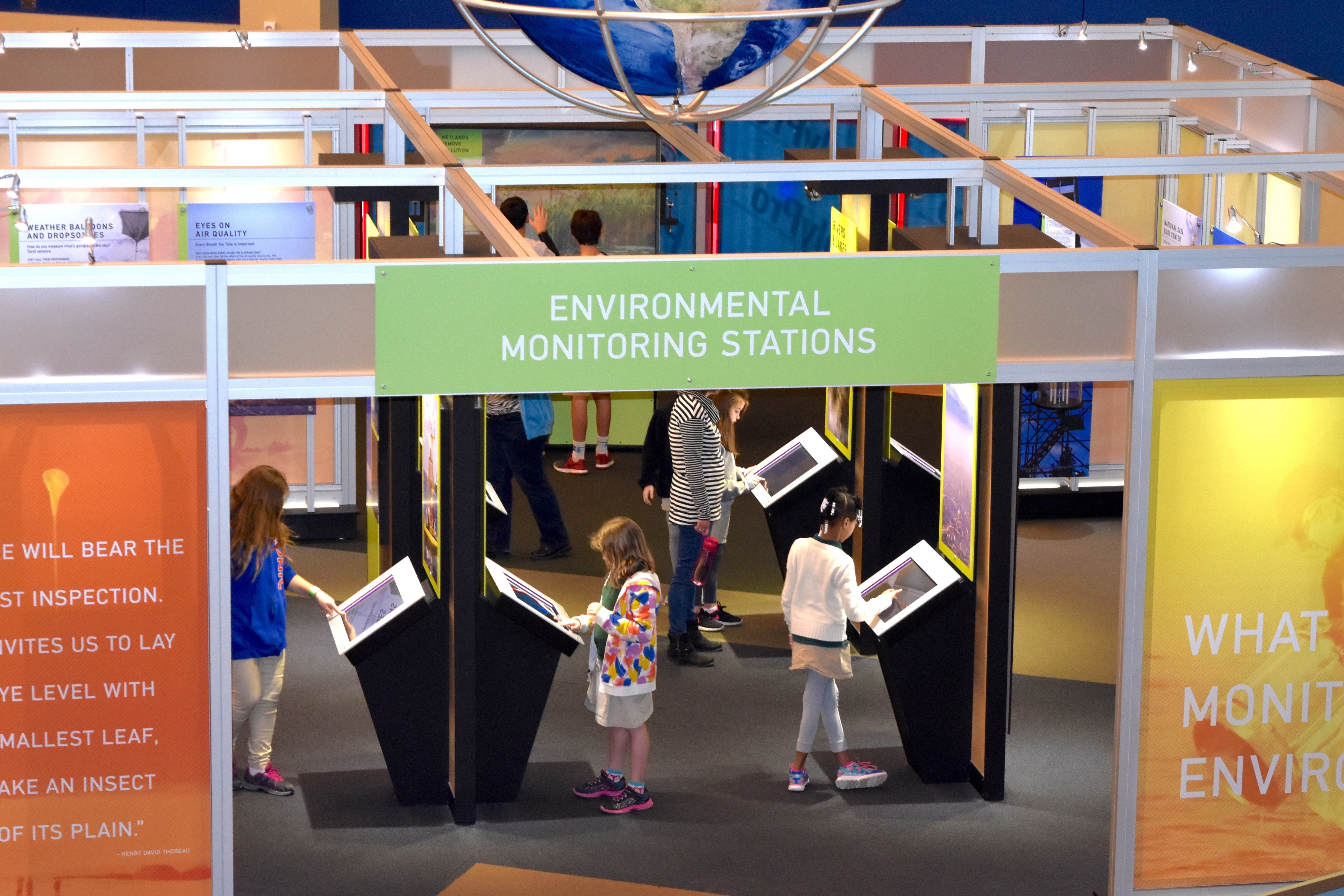 Children learning about environmental monitoring at a new exhibit at the Infinity Science Center.