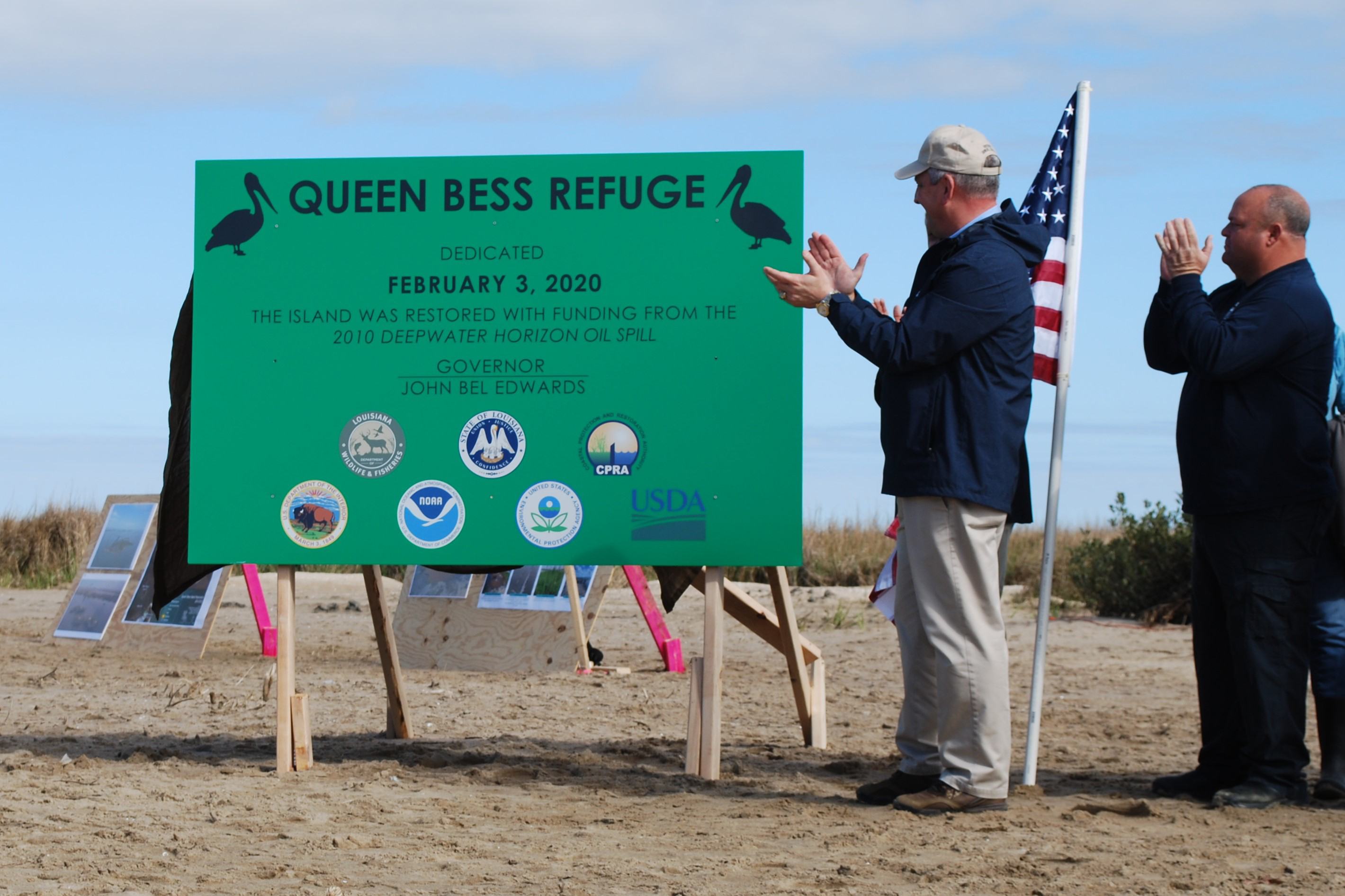 Governor John Bell Edwards in front of a project dedication sign.