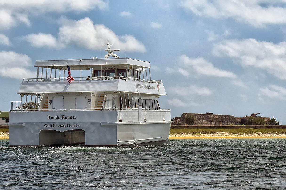 A ferry motoring away toward its destination.