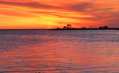 Sunset over the water in Apalachicola, FL