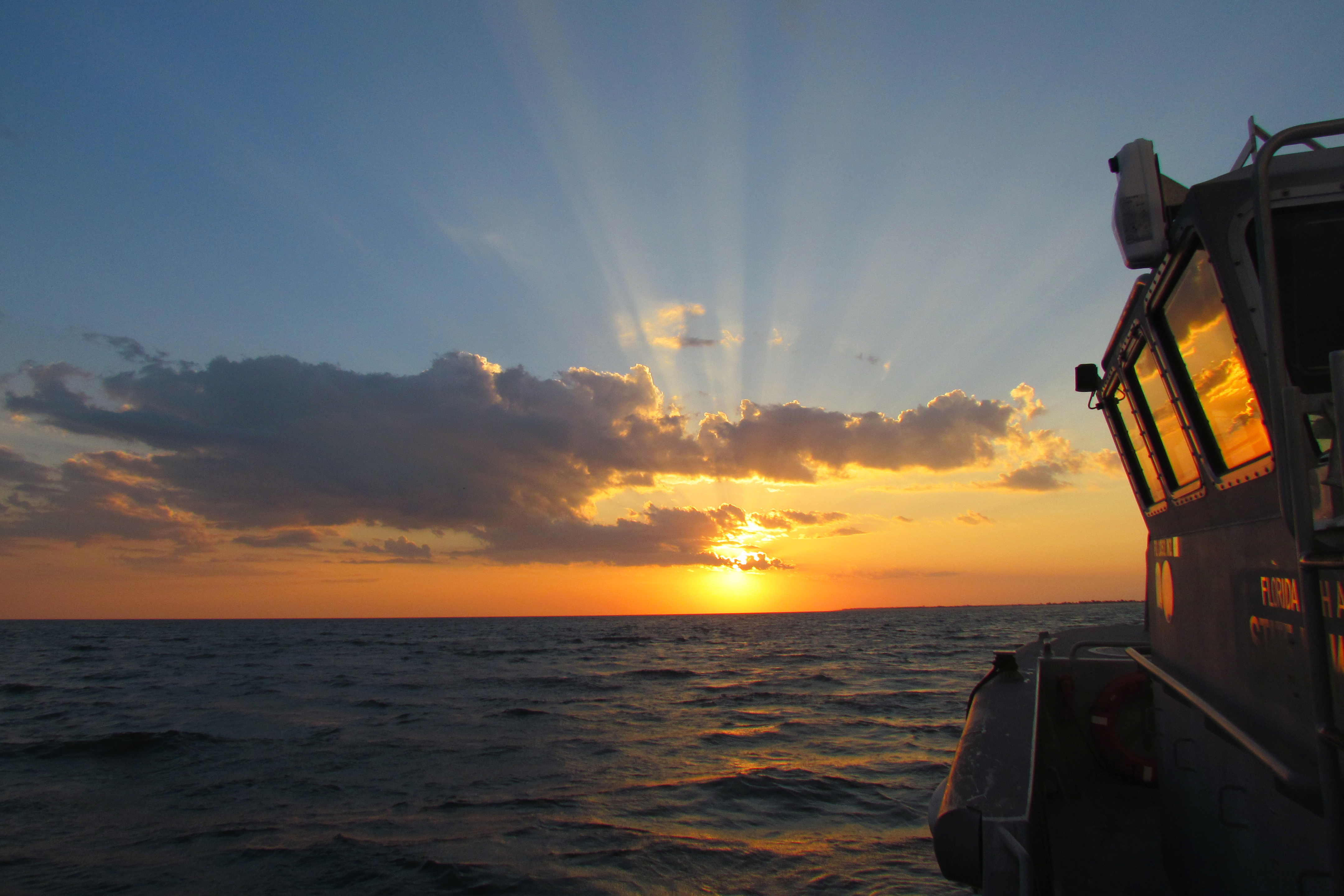 View of the sun setting over the Gulf of Mexico from a vessel.